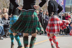 Saint Patrick`s day young women dancing. Group young females Scottish dance Stock Photos