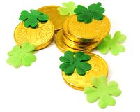 Saint Patrick's Gold and clover. Saint Patrick's Gold and green clover leaves on white background Royalty Free Stock Image