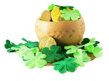 Saint patrick's pot with gold and shamrock. Saint patrick's pot filled with gold and shamrock around it isolated Stock Images