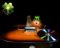 Saint Patrick's rockin' Leprechaun over black. Saint Patrick's musician Leprechaun and electric guitar over black Royalty Free Stock Photos