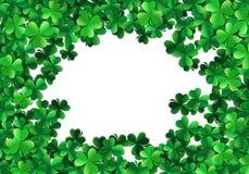 Saint Patricks day background with sprayed green clover leaves or shamrocks. Saint Patricks day background with sprayed clover leaves or shamrocks Stock Images