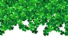 Saint Patricks day background with sprayed green clover leaves o. Saint Patricks day background with sprayed clover leaves or shamrocks Stock Photography