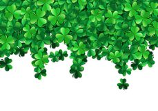 Saint Patricks day background with sprayed green clover leaves or shamrocks. Saint Patricks day background with sprayed clover leaves or shamrocks Stock Image