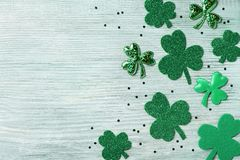 Free Saint Patricks Day Background With Green Shamrock On White Rustic Board Top View. Stock Photo - 108631960