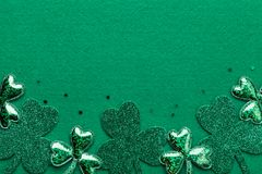 Saint Patricks Day border with shamrock on green background from above. stock image