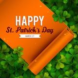 Saint Patricks Day card, ribbon on shamrock leaves Stock Photography