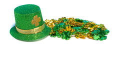 Saint Patricks Day decoration with a hat and beads Royalty Free Stock Photo