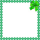 Saint Patricks Day elegant border with shamrocks and festive bow. Saint Patricks Day elegant border with shamrocks, festive bow and copy space on white Royalty Free Stock Image