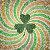 Saint Patricks Day Greeting Card with Clover Leaf on Abstract Geometric Fanning Twirl Rays Background in Vintage Shades of Green a Stock Images