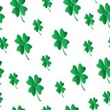 Saint Patricks day pattern with four leaf clover. White background Royalty Free Stock Photo
