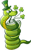 Saint Patricks Day Snake. Green snake wrapping her body around a glass and drinking green beer to celebrate St Patricks Day Royalty Free Stock Photography