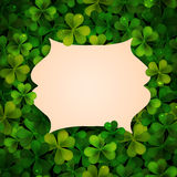 Saint Patricks Day vector background, realistic shamrock leaves and frame Royalty Free Stock Images