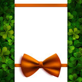 Saint Patricks Day vector background, realistic shamrock leaves and orange bow Royalty Free Stock Image