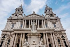 Saint Paul Cathedral and statue of Queen Anne in London, UK.  Royalty Free Stock Images
