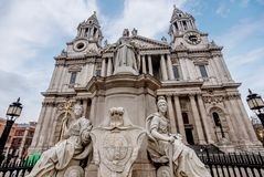 Saint Paul Cathedral and statue of Queen Anne in London, UK. London, UK- January 12, 2018:Saint Paul Cathedral and statue of Queen Anne in London, UK Stock Images