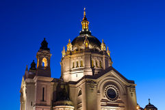 Saint Paul Cathedral Under Blue Sky. Saint Paul Cathedral illuminated at dusk under a deep blue sky in capital city of Minnesota stock photography