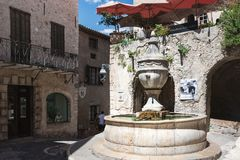 Saint-Paul-de-Vence, Alpes-Maritimes department, French Riviera, july 2017, Place de la Grande Fontaine - the main place in the v. Illage of artists royalty free stock photography