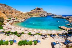Lindos Acropolis and beach, Rhodes. Saint Paul\'s Beach and Lindos Acropolis aerial panoramic view in Rhodes island in Greece stock image