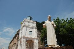 Saint Paul`s Church and St. Francis Xavier Statue stock image