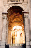 Saint Peter's Passage to Cupola. An ornate passageway located on the left side of Saint Peter's Basilica, guarded by the Swiss Guards that leads into Vatican Royalty Free Stock Photo