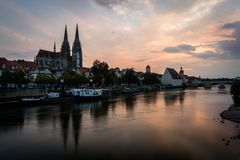 Saint Peter cathedral in Regensburg, Bavaria, Germany. Cityscape image over the Danube river during sunset. Royalty Free Stock Photography