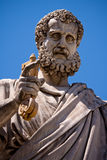 Saint Peter holding the key to heaven. Statue located in Saint Peter's square  in the Vatican, Italy Stock Photography