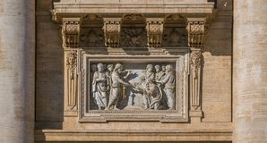 `Saint Peter receiving the Keys` by Ambrogio Buonvicino over the main entrance to Saint Peter Basilica in Rome, Italy. stock photo