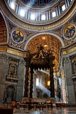 Saint Peter's baldachin. Brrnini's Saint Peter's baldachin under the dome of St. Peter's basilica in Rome, Italy Stock Photos