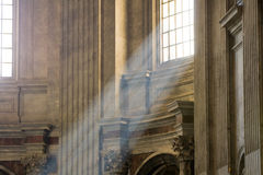 Saint Peter's basilica interior in Vatican. A powerful beam of light streaming through the large window stock photos
