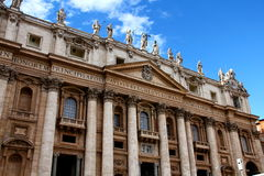 Saint Peter's Basilica, Rome. St Peter's Basilica facade with blue sky and clouds Royalty Free Stock Photography