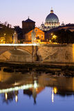 Saint Peter's Basilica on Tiber bank in evening Stock Image