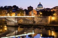 Saint Peter's Basilica on Tiber bank in evening Stock Photo