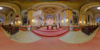 Saint Peter's Catholic Church Interior in Gherla, Romania. 360 panorama of from the altar of Saint Peter's Catholic Church lit up at night in Gherla, Romania Royalty Free Stock Photo