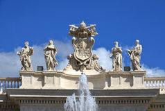Saint Peter's collonade with beautiful statues of saints and apo Royalty Free Stock Image
