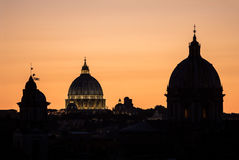 St. Peter's dome at sunset in Rome, Italy Stock Photography