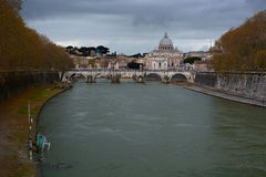 Saint Peters dome view from Tiber river. Roma, Ita. St. Peters Basilica is a Late Renaissance church located within Vatican City. The Tiber is the third-longest stock photo