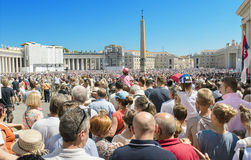Saint Peter's Square full of people and tourist waiting for pope Francis. Royalty Free Stock Photography