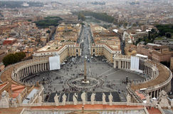 Vatican, Saint Peter's Square. Saint Peter's Square (Italian: Piazza San Pietro) is a massive plaza located directly in front of St. Peter's Basilica in t papal Royalty Free Stock Photo