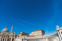 Saint Peter`s square under a blue sky Stock Photography