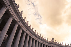 Saint Peter's Statues. A sunset view of Saint Peter's statues of saints in the Vatican City Royalty Free Stock Images