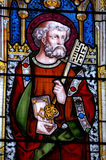 Saint Peter stained glass window. A Victorian stained glass window of Saint Peter holding the key to the gates of heaven Stock Photo