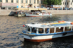 Saint Petersburg, Fontanka river and motor ships for excursion Stock Photos