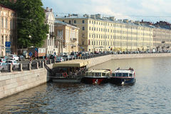 Saint Petersburg, Fontanka river and motor ships for excursion Royalty Free Stock Photo