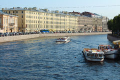 Saint Petersburg, Fontanka river. Russia, St.Petersburg. Fontanka river and boats for trip along rivers and channels of the city Stock Image