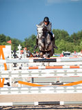 SAINT PETERSBURG-JULY 05: Stasys Jasas on Patrol V in the CSI3*- Stock Photos