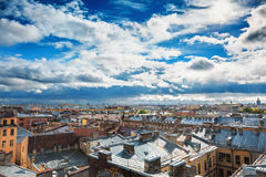 Saint Petersburg panorama, view from roof in the center of old city or downtown, dramatic sky, roofs of houses, horizon. HDR image Stock Photography