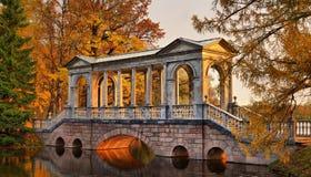 Marble bridge in Catherine garden in Pushkin. Saint-Petersburg. Pushkin. Panorama of the Marble bridge in Catherine Park at dawn Royalty Free Stock Images