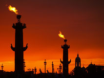 Saint-Petersburg- Rostral columns at the sunset. Saint-Petersburg- Rostral columns silhouette with fire Stock Photo