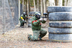Saint-Petersburg, Russia - April 24, 2016: Paintball tournament in Snaker club between student teams from five universities. Game process Stock Photography