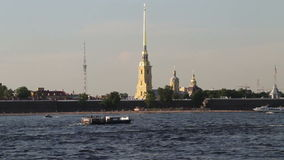 SAINT PETERSBURG, RUSSIA - AUG 2013: A lot of tourist boats float in front of Peter and Paul Fortress stock footage